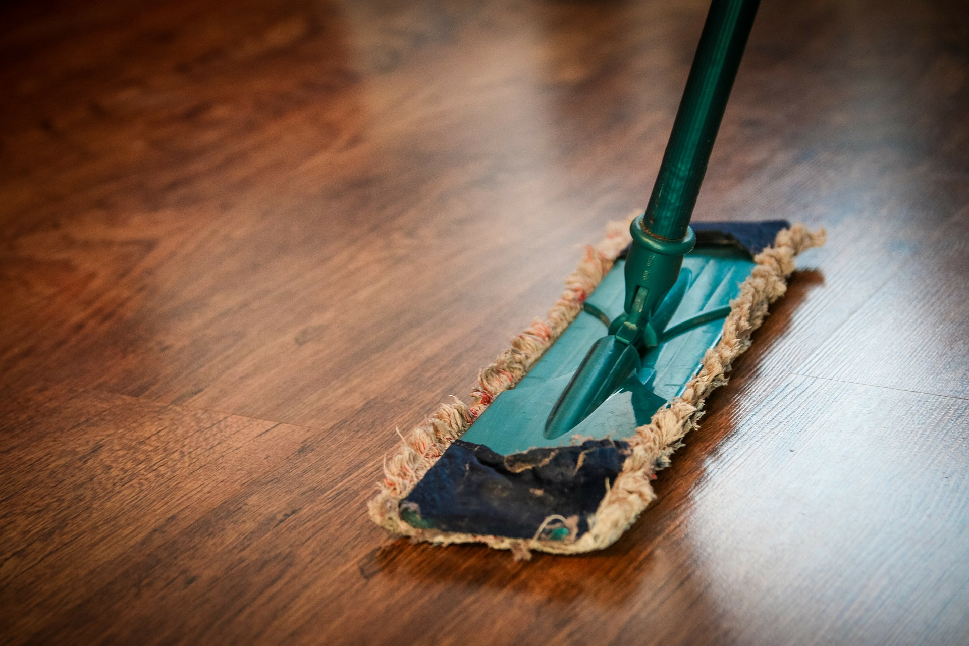 <p>Cleaning wooden floors</p>